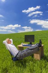 Businessman Relaxing Feet Up Desk in Green Field