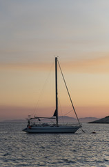 Sail Boat Yacht at Sunset or Sunrise
