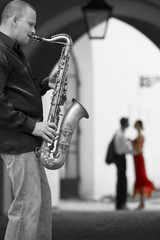 Saxophone Player With Romantic Couple
