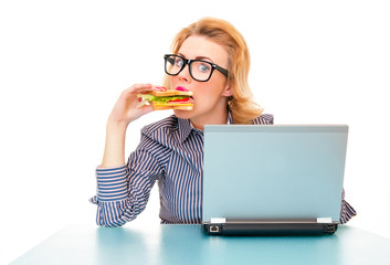 Funny hungry business woman eating sandwich on work,