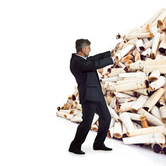 adult man pushes a bunch of cigarette butts