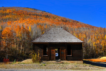 Abandoned cabin with autumn landscape