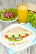 Composition with fruit juice and tasty sandwich with salami