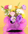 Beautiful flowers on yellow background