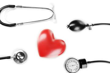 Tonometer, stethoscope and heart isolated on white