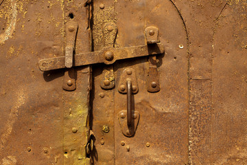 Old, rusty, door with lock