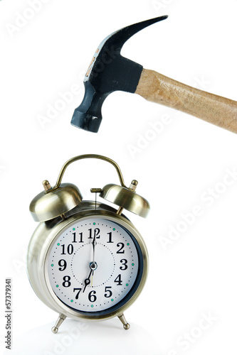 Hammer and alarm clock isolated on white