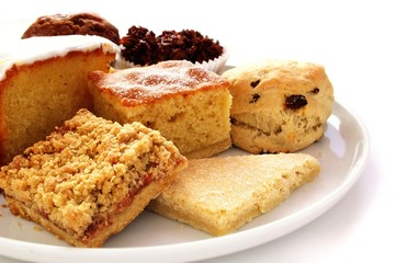 selection of baked cakes on white platter