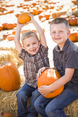 Two Boys at the Pumpkin Patch Talking and Having Fun.