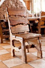 Massive wooden chair standing in dining room