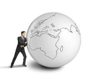 businessman pushing big ball