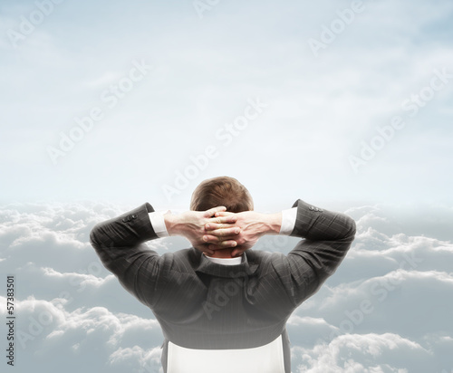 man looking at cloud