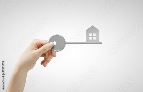 hand holding key house