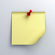 Yellow sticky note paper with red push pin on white background
