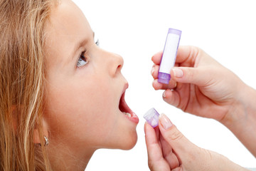 Young girl taking homeopathic medicine