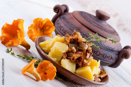 Chanterelle mushrooms with potatoes in a pot at home
