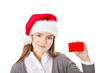 smiling christmas girl holding red empty card with place for tex