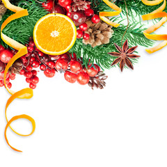 Christmas berries and spruce branch with cones and oranges