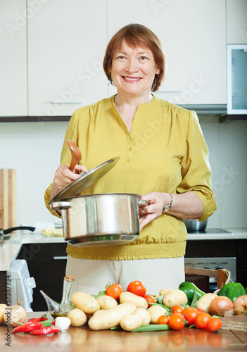 mature woman cooking  vegetarian lunch