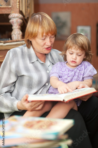 grandmother and child reading  book