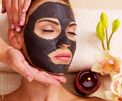 Cosmetologist doing massage on the woman's face  in sap salon