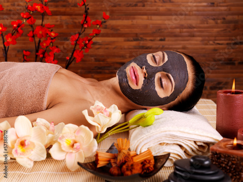 Adult woman relaxing in spa salon