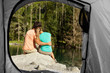 view of a couple that camps from the inside of a tent