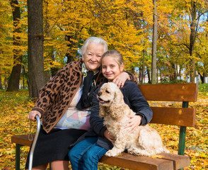 Grandmother and child sitting on the bench