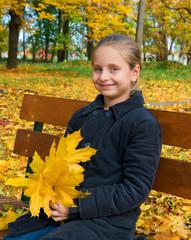 Autumn portrait of smiling little girl