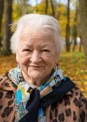 Old woman in autumn park