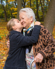 Granddaughter kissing her grandmother