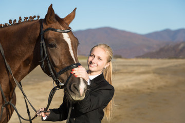 Happy girl teenager with his horse
