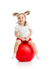 happy kid girl jumping on bouncing ball