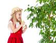 gardener kid wets or waters tree