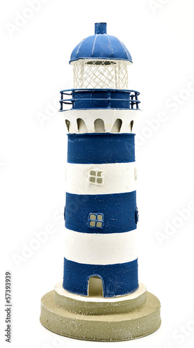 Blue and white striped lighthouse isolated
