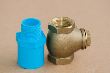 Bronze swing check valve and pvc pipe connection.