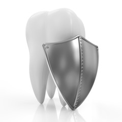 Tooth with metal shield on white background
