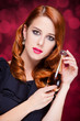 Redhead women at red background