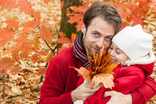 Smiling father and daughter having fun outdoor in autumn