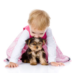 little girl playing and crawling with a puppy. isolated on white