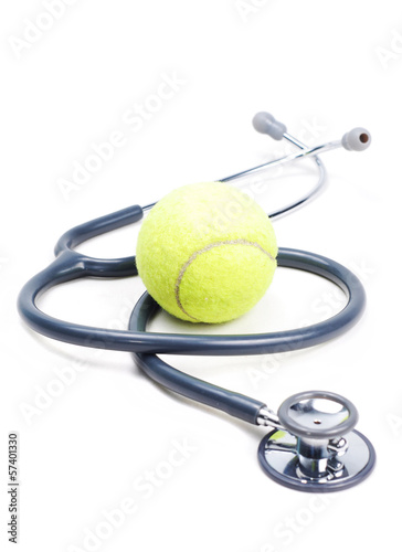 Stethoscope and tennis ball on isolate background