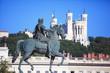Famous statue of Louis XIV and Basilique of Notre Dame de Fourvi