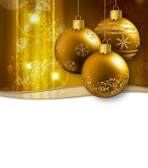 christmas baubles hanging on a glittering background