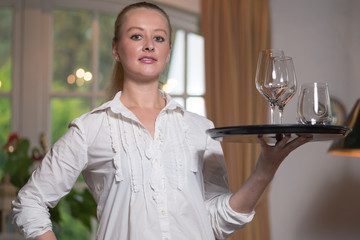 Young blond waitress in a restaurant