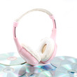 Pink headphone with CD on isolate white background