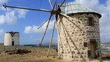 old windmill with white clouds and blue sky (tilt shoot)