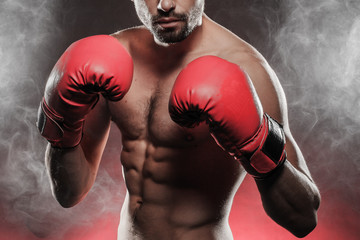 mens torso wearing boxing gloves