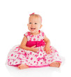 happy little baby girl in bright pink festive dress isolated