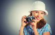 young female photographer with retro camera