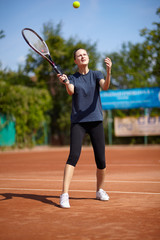 Tennis player executing a forehand volley